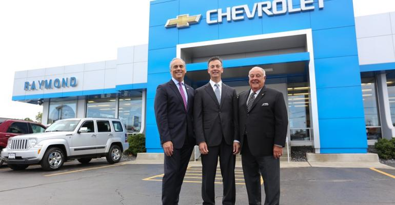 Mark Scarpelli right with brother Ray Scarpelli and father Raymond Scarpelli Sr at the family Chevy Store