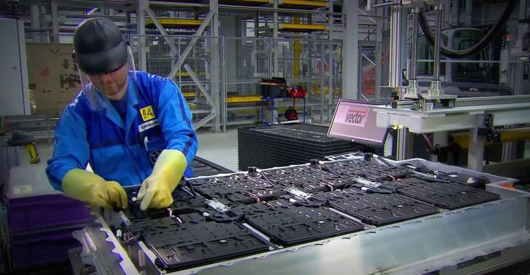 Worker assembles BMW i3 extendedrange electric vehiclersquos battery