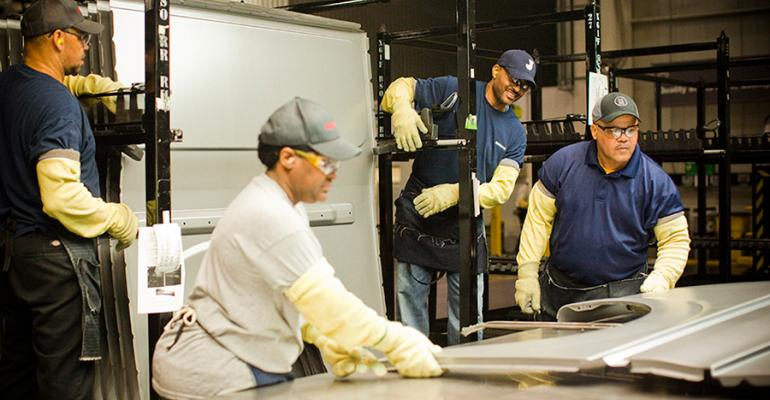 Technicians inspect metal stampings at Nissanrsquos Canton MS plant