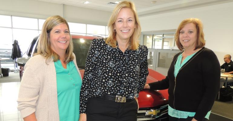 From left Simpson Coleman and Jensen in John Bowman Chevrolet showroom