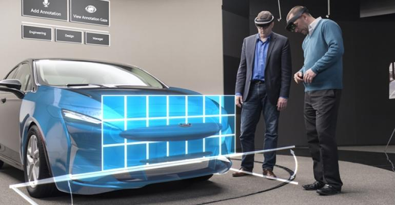 Designers measure front approach angle of virtual grille projected on physical vehicle