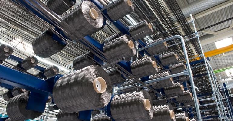 SGL carbon fiber yarn gets spooled on bobbins