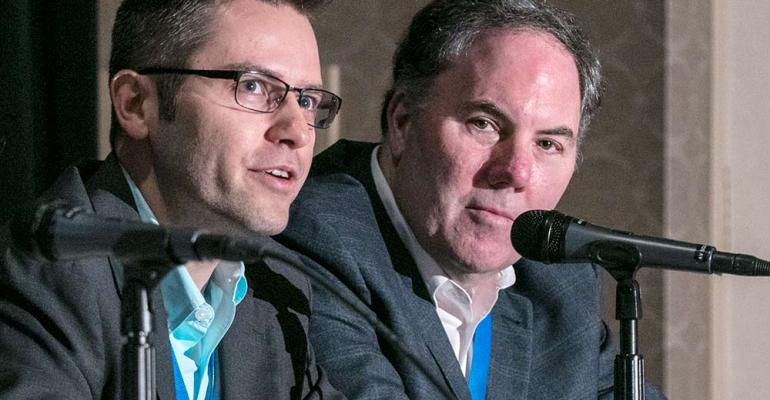 Jacek Spiewla from Mitsubishi Electric and Faureciarsquos Robert Kinney field questions after UX panel session