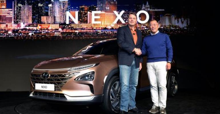 Aurora Innovation CEO Urmson left Hyundai Motor vice chairman Chung introduce NEXO fuelcell vehicle at CES in January