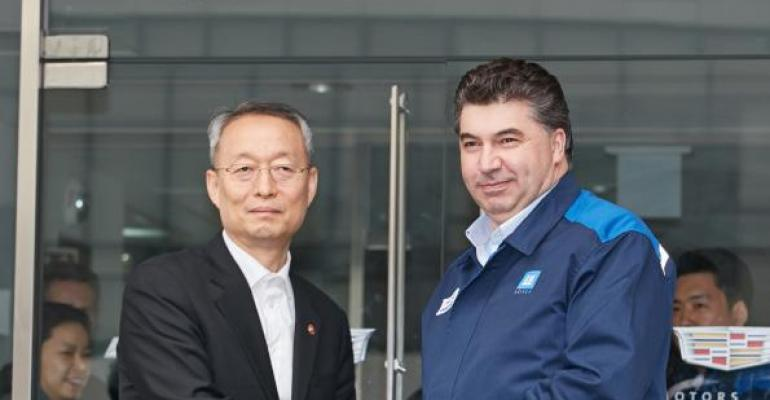 CEO Kazem right welcomes Korea Development Bank Chairman Lee to GM Korea headquarters April 6