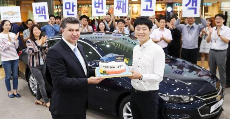 GM Korea President Kaher Kazem with feted buyer of companyrsquos 1 millionth vehicle a Chevrolet Malibu in September 2017